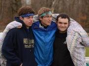 Riley, Logan, and Cody huddle up
