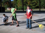 Henry and Jesse sweep up at the rink
