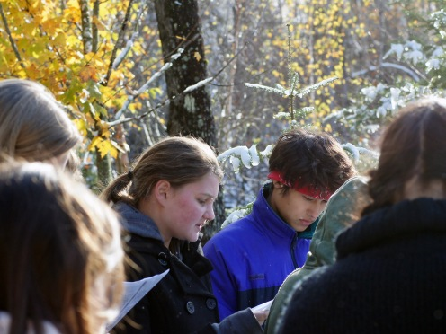 Sarah and Conner read about first snow in History Class