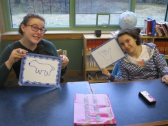 "Ellie and Espoir practice their environmental vocabulary. Quick, draw a bear... ""oso""!"