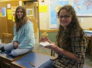 Marissa and Kaya enjoy some pan de muerto on Friday's Día de Muertos class.