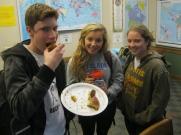 Steve, Siri and Katelynn enjoy pan de muerto on Friday's Día de Muertos class.