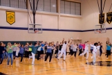 "Guest Capoeirista ""Siriema"" lead students and staff in a warm up to loosen up and feel the Brazilian rhythms."