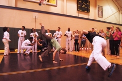 "Woogie throws an ""au"" while playing a game with Mike, one of the Capoeiristas."
