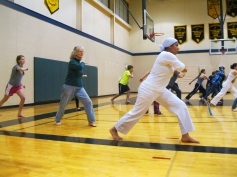 Conserve art teacher Nancy Schwartz stopped in to learn a few moves, too! Capoeirista Asiya demonstrates.