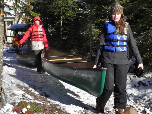 Woogie and Carly put a canoe in the water