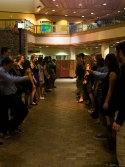 CS7 students learning how to dance after the dinner