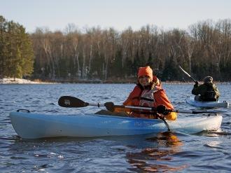 Field Instructor Fiskars watches from a kayak