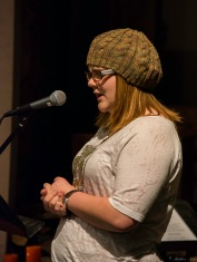 Randa reads a story for the open mic