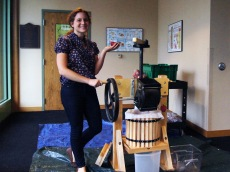 Grad Fellow Rebecca shows off the new apple press
