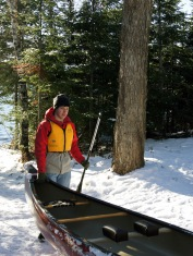 Riley helps load his canoe into the water