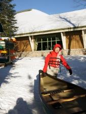 Woogie helps load a canoe