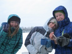 Erin, Sarah and Emily enjoy a cocoa booster on Lake Elaine.