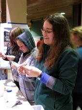 Grad Fellow Kelly helps roll a few beads