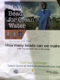 Students track their bead count on a poster in the LAB