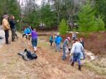 Students working on restoring a native landscape