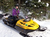 14-02-08 Three Bear Sled Dog Races Posing on Snowmobile Rebecca