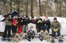 Nate, Bridger, Antonia, Marina, Abby, Sarah, Erica, Natalie, and Jake enjoy a break from snowshoeing in Sylvania