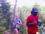 Runners concentrate on their footing on the single track overlooking Lake Elaine