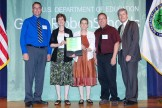 Conserve School Group with award from Dept of Ed