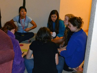 A small group discussing one of the values in Elaine House
