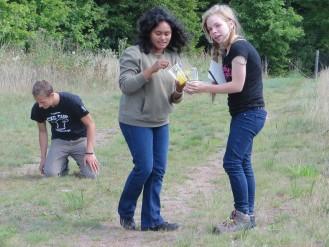 Grace and Rowan marking grass hoppers