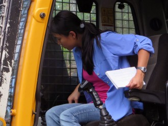 Jayleen checks out the cab of the processor