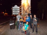 In front of T.J. Grizzlie's Pizza