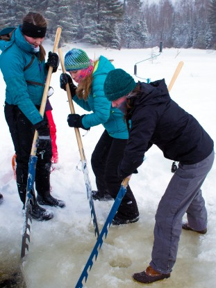 Amelia, Shannon, and Risa cutting ice