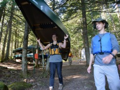 Amelia bringing a canoe to the lake