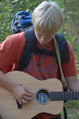 Charlie strumming some chords