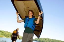 Aidan portaging a canoe