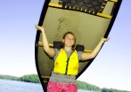 Lexie lifts the canoe to begin a portage