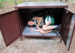 Donelle testing out the bear locker in the Pictured Rocks