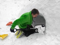Alex digging out the quinzhee. Photo by CS12 student Niko.